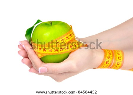 Woman palm, geen apple and measuring tape isolated on white