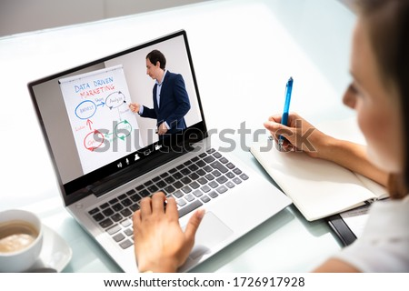 Woman Participating In Online Coaching Session Using Laptop