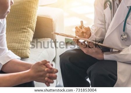 Woman patient having consultation with doctor (gynecologist or psychiatrist) and examining  health in medical gynecological clinic or hospital mental health service center Foto stock ©