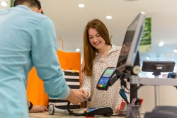 Woman paying for apparel in store