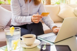 Woman paying online with credit card