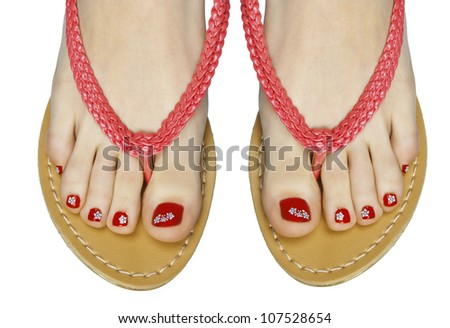 woman pedicured feet in flip flop summer sandals