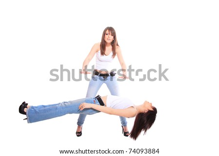 woman performing levitation on her frind