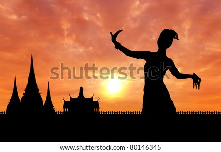 woman performing typical thai dance silhouetted with thai style temple background, identity culture of thailand