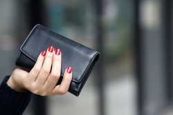 woman person holding a wallet in the hand. Cost control expenses shopping in concept. Leave space to write descriptive text.