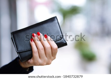 woman person holding a wallet in the hand. Cost control expenses shopping in concept. Leave space to write descriptive text. Сток-фото ©