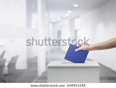 Woman person vote with ballot box at office voting concept.