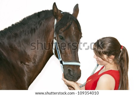 woman petting her horse showing complicity between them
