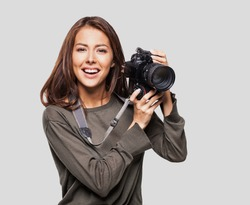 Woman photographer is taking images with dslr camera