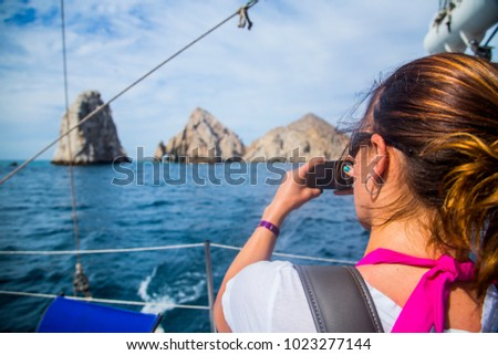 Woman Photographs Marine Life on a Whale Watching Tour in Mexico