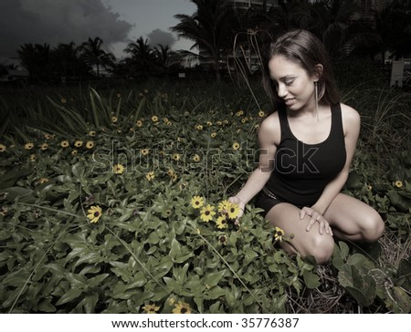 Woman picking daisies