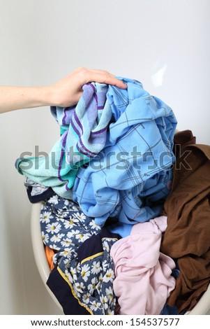 woman Pile of dirty laundry in bath washing machine green bathroom