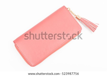 Woman pink purse isolated on the white background. Closeup of modern pink leather wallet over white background. Top view on the wallet. Сток-фото ©