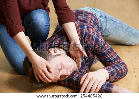 woman placing man in recovery...