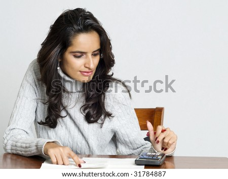 Woman planing and calculating bill payments - stock photo