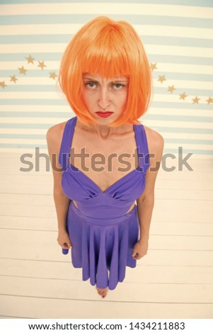 Woman playful mood having fun. Fun and entertainment. Lady actress practicing performance. Girl posing striped background of studio. Lady red or ginger wig posing in blue dress. Comic actress concept. #1434211883