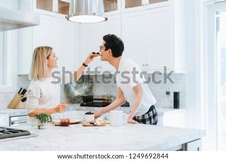 Woman playfully feeding her boyfriend #1249692844