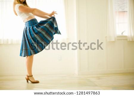 Woman playfully lifting her skirt #1281497863