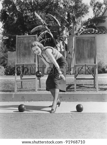 Woman playing bocce outdoors