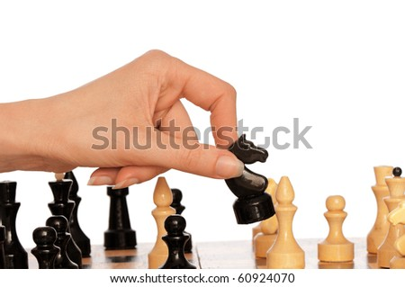 Woman playing chess and making black knight's move