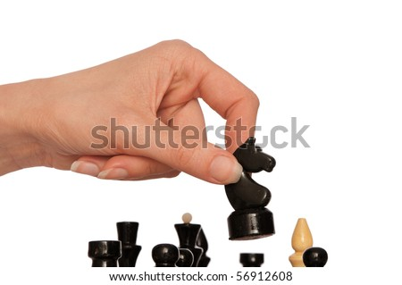 Woman playing chess and making black knights move