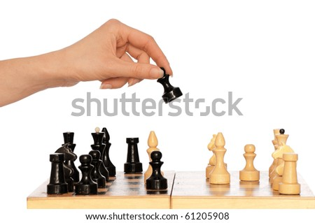 Woman playing chess and making black pawn move