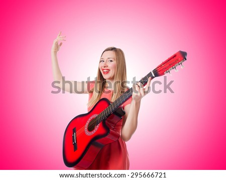 Woman playing guitar against the gradient  #295666721