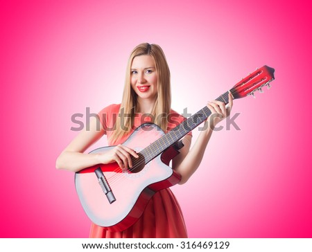 Woman playing guitar against the gradient  #316469129