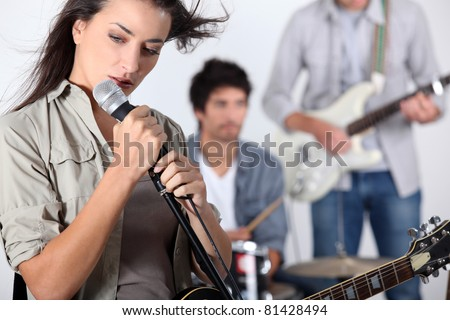 Woman playing in a band