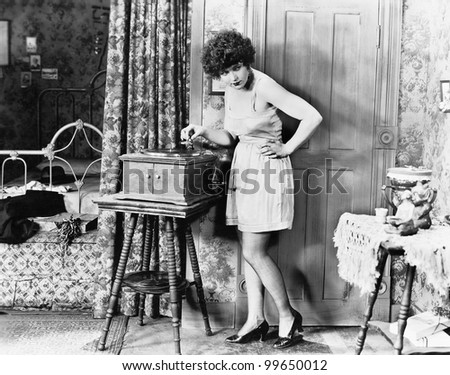 Woman playing record player