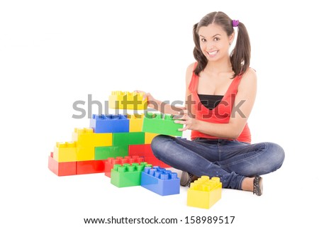 woman playing with blocks
