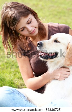 Woman playing with her dog outdoors