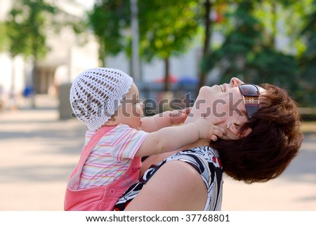 Woman playing with small baby