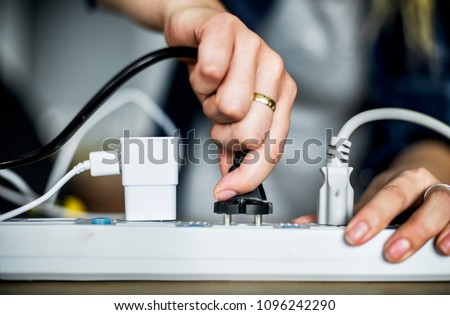 Woman pluging the wire