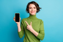Woman point finger smartphone screen isolated blue color background
