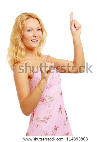 woman pointing at a copyspace isolated on a white background