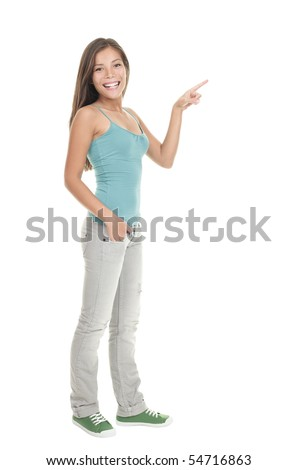 Woman pointing to the side standing in full length - isolated on white background.