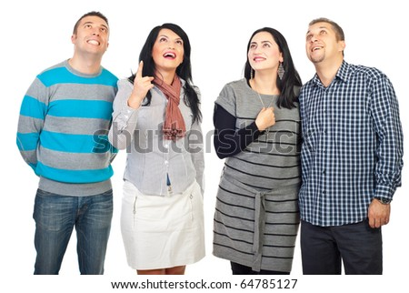 Woman pointing up and all group of friends looking up with happy surprised faces isolated on white background