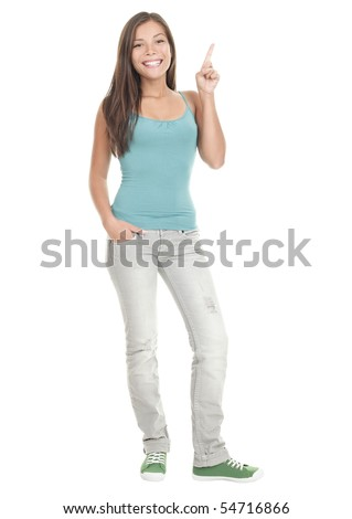 Woman pointing up standing in full length - isolated on white background. Young Asian Caucasian female model.