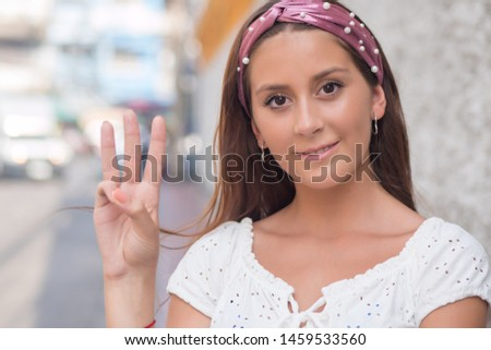 woman pointing up three fingers, number 3, third, 3 important keys, counting concept #1459533560