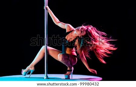 woman pole dancer performing act