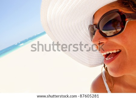 Woman portrait at the beach looking very happy