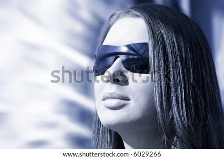 Woman portrait. Blue tint, hi-tech style.