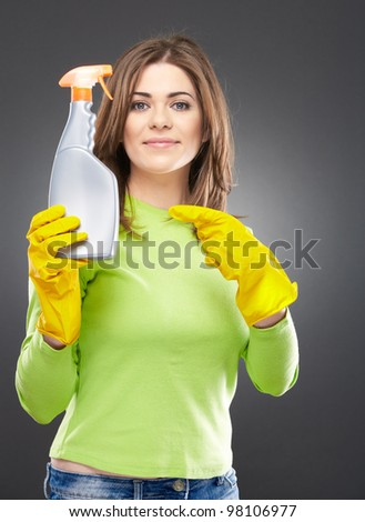 Woman portrait hold  spray for windows cleaning. Isolated on gray background with yellow gum glove