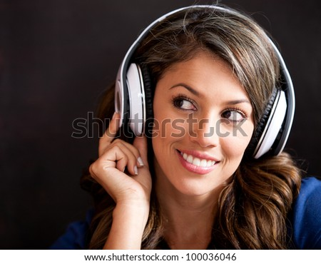 Woman portrait listening to music with headphones