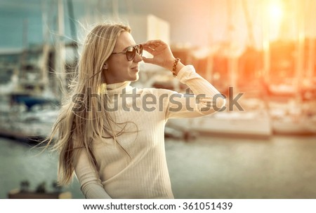Woman portrait on the yacht background under sunlight.