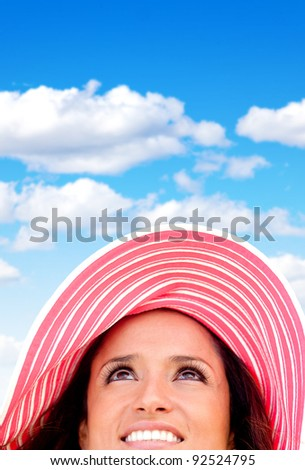 Woman portrait wearing a summery hat on a beautiful day