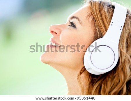 Woman portrait with headphones listening to music