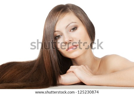 woman portrait with long shiny laying hair on horizontal surface
