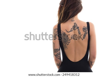Woman portrait with tattoo against white background with copy space.